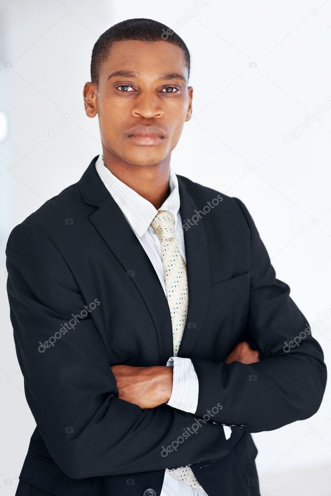 Portrait of a confident young american african businessman looking with attitude  Stock Photo #7815878