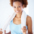 Happy woman relaxing after working out at gym - Stockfoto
