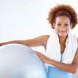 Royalty-Free Stock Photo: Happy fit young woman holding a fitness ball