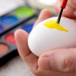 Royalty-Free Stock Photo: Hand painting easter egg with paintbrush