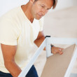Man building shelf - Stock Photo