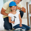 Royalty-Free Stock Photo: Father putting on an helmet on his daughter