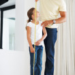 Young girl getting her height measured - Stock Photo