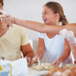 Family enjoying in kitchen - Stock Photo