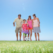 Royalty-Free Stock Photo: Family playing football on grass
