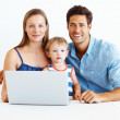 Royalty-Free Stock Photo: Family of three using laptop