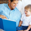 Royalty-Free Stock Photo: Father reading a story to his son