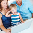Royalty-Free Stock Photo: Cute family of three using laptop