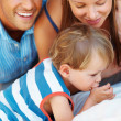 Young kid with parents - Stock Photo