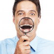 Royalty-Free Stock Photo: Mature business man with magnifier glass in front of his mouth