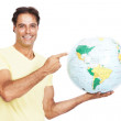 Mature man showing his next travel destination - Stock Photo