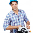 Male worker with a circular saw against white - Photo