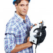 Construction worker with a circular saw over white - ストック写真