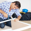 Mature handyman busy working at his worshop - Foto de Stock