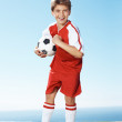 Royalty-Free Stock Photo: Little strong footballer standing outdoors