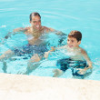 Royalty-Free Stock Photo: Father and son having fun in a swimming pool