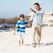 Royalty-Free Stock Photo: Happy father and son enjoying their weekend at the beach
