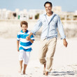 Royalty-Free Stock Photo: Happy father and son strolling on the sea shore