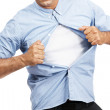 Royalty-Free Stock Photo: Casual man pulling off his shirt over white