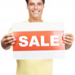 Royalty-Free Stock Photo: Happy man holding a sale sign board