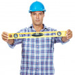 Royalty-Free Stock Photo: Manual worker holding spirit level isolated on white