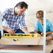 Royalty-Free Stock Photo: Father and son working together in workshop
