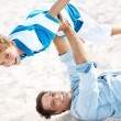 Royalty-Free Stock Photo: Father playing with his son on the beach