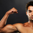 Royalty-Free Stock Photo: Confident muscular man flexing biceps