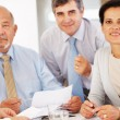 Three executives with business document - Stock Photo