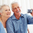 Royalty-Free Stock Photo: Senior man taking picture with his wife