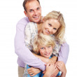 Happy young family with son posing over white - Stock Photo