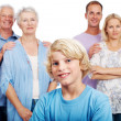 Royalty-Free Stock Photo: Cute young boy with his parents and grandparents in background
