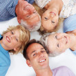 Royalty-Free Stock Photo: Happy family lying on the floor with heads together