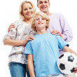 Royalty-Free Stock Photo: Small boy holding a football with his parents