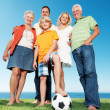Royalty-Free Stock Photo: Happy family standing together with a football