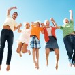 Lively excited family jumping in air - Enjoying holidays - Stock Photo