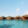 Water bungalows of hotel on the tropical island - Stock Photo