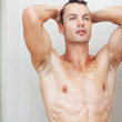 Royalty-Free Stock Photo: Good looking man taking shower