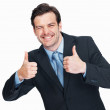Business man giving thumbs up gesture - Stockfoto