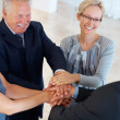 Happy business joining hands - Stock Photo