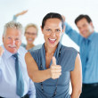 Royalty-Free Stock Photo: Business woman celebrating success with team