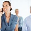 Business woman on call with colleagues - Stock Photo