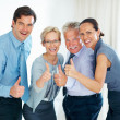 Royalty-Free Stock Photo: Business team giving thumbs up