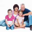 Grandparents and granddaughters smiling together - Stockfoto