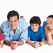 Royalty-Free Stock Photo: Happy parents with kids lying on the studio floor