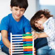 Brothers with abacus - Stock Photo
