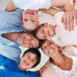 Royalty-Free Stock Photo: Happy family huddling together