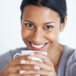 Cheerful woman having coffee - Stock Photo