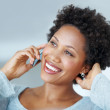 Royalty-Free Stock Photo: Happy African American woman on phone