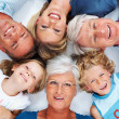 Royalty-Free Stock Photo: Happy three generation family lying down together